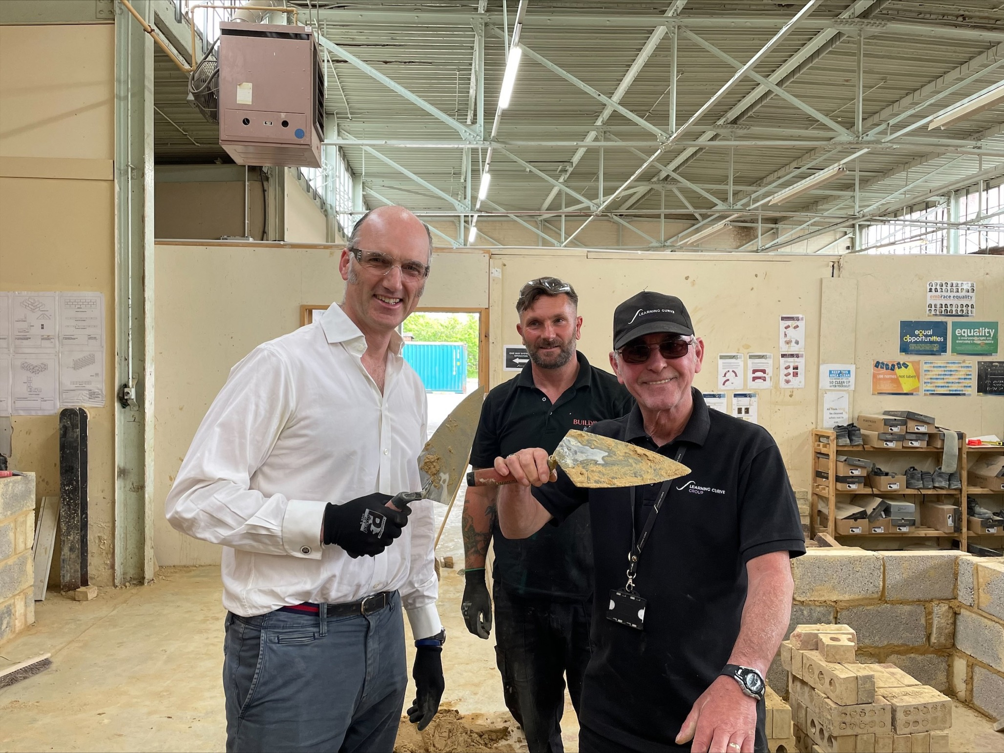 MP LEO DOCHERTY VISITS LCG CONSTRUCTION ACADEMY.png